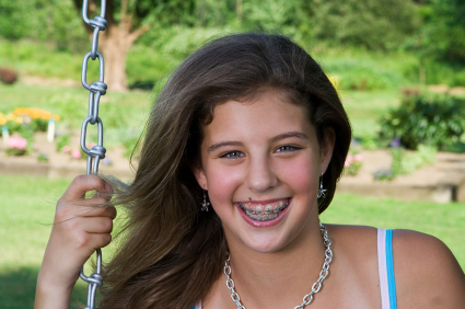 Girl with Braces at the Pediatric Dentist in Alpharetta